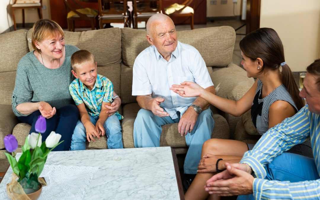 Grandparents talking to children and grandson